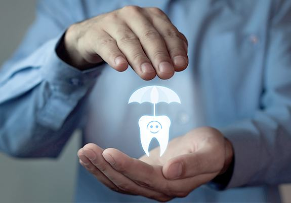Hand holding an animated tooth and umbrella