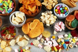 Table spread with foods to avoid after dental implant surgery